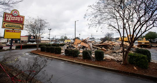 The Wendy's on Madison Avenue in downtown Montgomery, Ala., is demolished on Friday morning January 24, 2020.