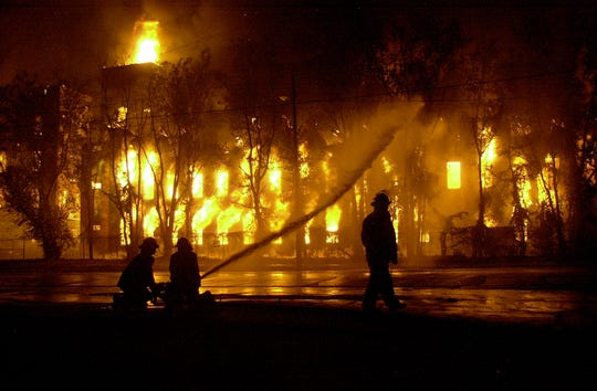 Prattville firefighters work to control a fire at the Gurney Building Tuesday night, Sept. 10, 2002.