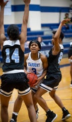 Marbury's Renijah Brown (3) is double teamed by Brewbaker Tech's Taria Edwards (14) and Tynthia Bedgood (23) on the Marbury campus in Marbury, Ala., on Thursday January 23, 2020.
