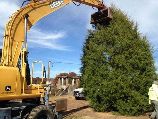 Crews put up Prattville's Christmas tree on on the lot where the Gurney Building once stood in this file photo
