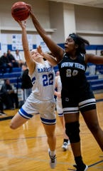 Brewbaker Tech's Nina Johnson (20) blocks a shot by Marbury's Dalyce Sanders (22) on the Marbury campus in Marbury, Ala., on Thursday January 23, 2020.