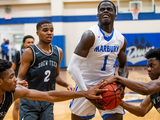 Marbury's Jakhiel Waller (1) has the ball takes by Brewbaker Tech on the Marbury campus in Marbury, Ala., on Thursday January 23, 2020.