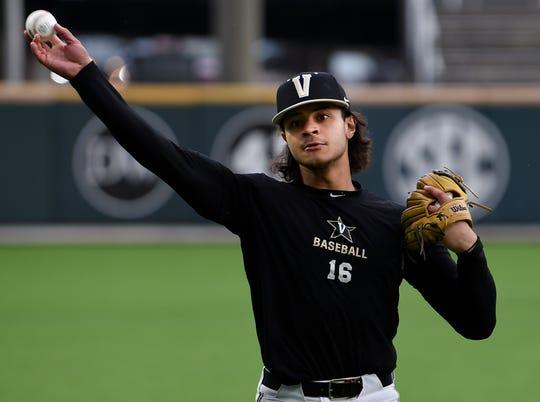 Vanderbilt third baseman Austin Martin (16) throws the ball as he warms up during their first practice of the season at Hawkins Field Friday, Jan. 24, 2020 in Nashville, Tenn.