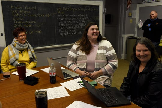 Christy Huy, Amanda Sillin and Coleen Slagle laugh while recalling how excited the kids were to run fire drill during a board meeting of the Excellence in Learning Community Co-Op in Newark. The Co-Op has been providing support and community to homeschooling families for 10 years. During the meeting they brainstormed ideas for future class offerings.