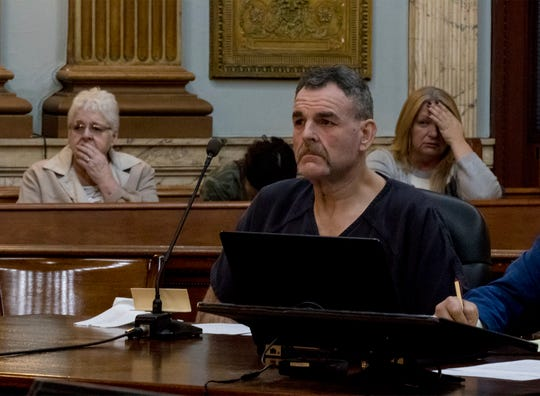 Stephen Wolfe and his family (seated behind him) react as he was sentenced to 9 and a half to 11 years in prison for leading police on a high speed chase for 50 miles. Wolfe led police through Marion, Muskingum, Licking and Coshocton counties while driving upwards of 100 miles per hour in a semi. He injured one person in Licking County.