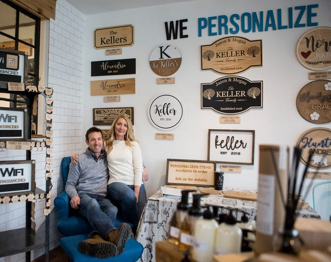 Megan and Jason Keller of Matchmade Designs in Alexandria, Ohio make personalized signs for customers.
