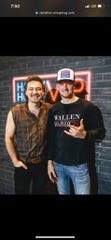 Johnstown graduate Michael Perkins, right, takes a photo with Morgan Wallen during a meet-and-greet session. On Jan. 18, Perkins shot-gunned a beer with Wallen on stage during a concert in Cincinnati days before Perkins' deployment overseas.