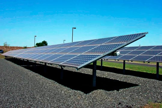 Solar panels manufactured by China's Yingli Green Energy Holding Co. convert sunlight into electricity on the Livingston Campus of Rutgers University in New Brunswick, New Jersey