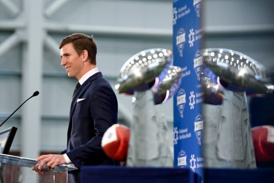 New York Giants quarterback Eli Manning announces his retirement with the two Vince Lombardi trophies he won for the Giants on display during a press conference at Quest Diagnostics Training Center on Friday, Jan. 24, 2020, in East Rutherford.