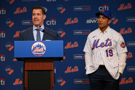 Luis Rojas, right, listens in as New York Mets General Manager Brodie Van Wagenen talks after being introduced as the team's new manager at Citi Field on January 24, 2020 in New York City. Listening in is the team's general manager . Rojas had been the Mets quality control coach and was tapped as a replacement after the newly hired Carlos Beltran was implicated for his role as a player in 2017 in the Houston Astros sign-stealing scandal.