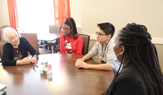 Glenda Adelman, a resident of Arbor Terrace, talks with Teaneck students.