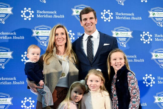 New York Giants quarterback Eli Manning poses for photos with his wife Abby and their children at Quest Diagnostics Training Center on Friday, Jan. 24, 2020, in East Rutherford.