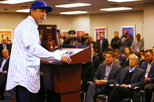 Luis Rojas speaks after being introduced as the new manager of the New York Mets at Citi Field on January 24, 2020 in New York City. Looking on in the front row are Chief Operating Officer Jeff Wilpon and Chairman of the Board & Chief Executive Officer Fred Wilpon.