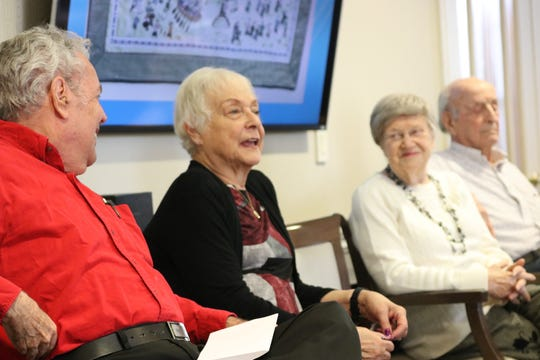 Arbor Terrace residents talk to the middle school students.