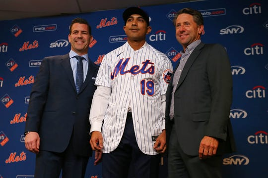 Luis Rojas stands between General Manager Brodie Van Wagenen and Chief Operating Officer Jeff Wilpon after being introduced as the new manager of the New York Mets at Citi Field on January 24, 2020 in New York City. Rojas had been the Mets quality control coach and was tapped as a replacement after the newly hired Carlos Beltran was implicated for his role as a player in 2017 in the Houston Astros sign-stealing scandal.