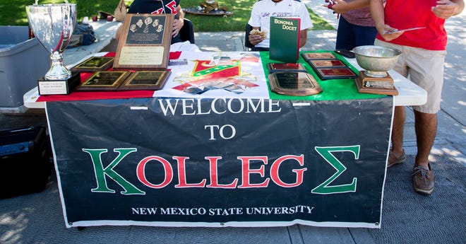 Members of the Kappa Sigma fraternity man a recruiting table on the International Mall during NMSU's first day of class, Wednesday, Aug. 17, 2016.