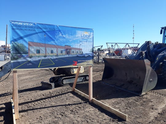 An artist rendering announces the future site of the La Clinica de Familia Behavioral Health Complex is displayed during a ground-breaking ceremony on Thursday, Jan. 24, 2020. The new facility will be located at 515 S. Miranda St. in Las Cruces.