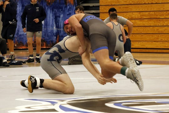 Carlsbad's Arturo Estrada, top, takes down Goddard's Wyatt Bisby to record a 48-second pinfall victory during their 132-pound match on Jan. 23, 2020. Carlsbad won the district dual, 71-12.