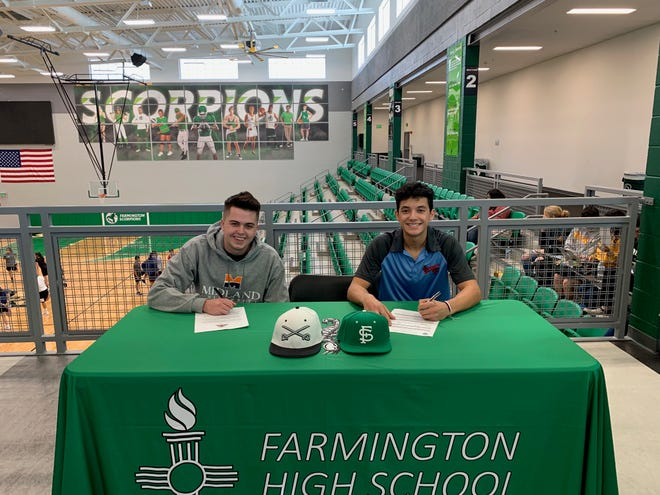 Farmington baseball players Jay Alshouse and Emilio Pardo sign their national letters of intent on Friday. Alshouse will play at NAIA's Midland University in Fremont, Nebraska, while Pardo will play at New Mexico Military Institute's junior college baseball team in Roswell.