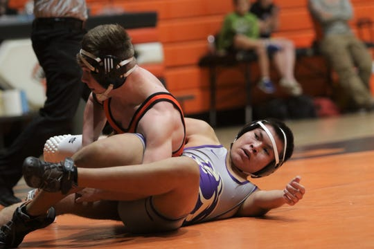 Kirtland Central's Jayden Franklin looks to break free from Aztec's Hunter Riddick in the 170-pound division match during Thursday's District 1-4A wrestling opener at Lillywhite Gym in Aztec.