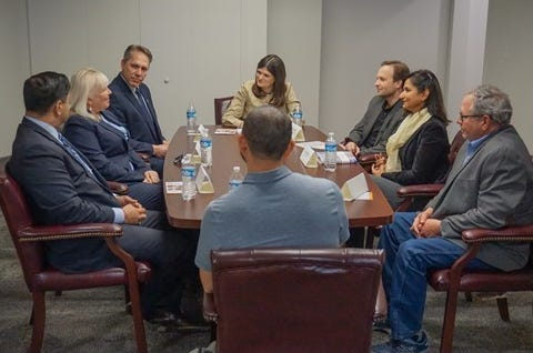 Congresswoman Haley Stevens, back center, with small business owners on Thursday.