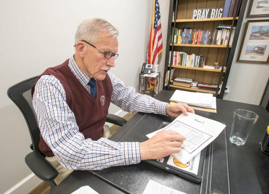 Frank Lay, founder and administrator at L.E.A.D. Academy Classical School, talks Friday about plans to build a new gymnasium and cafeteria building to accommodate the school's growth.