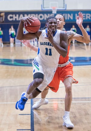 Tarik McKelphin (11) takes it to the hoop during the Auburn University at Montgomery vs UWF men's basketball game at the University of West Florida in Pensacola on Thursday, Jan. 23, 2020