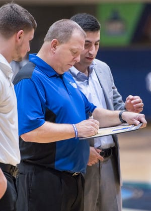 Head coach Jeff Burkhamer, center, draws up a play in a time out during the Auburn University at Montgomery vs UWF men's basketball game at the University of West Florida in Pensacola on Thursday, Jan. 23, 2020