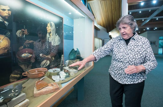 Judy Bense, former president of the University of West Florida, gives a tour of the university's Archaeology Museum in Pensacola on Thursday.