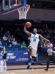 Tarik McKelphin (11) leaps to slam dunk the ball during the Auburn University at Montgomery vs UWF men's basketball game at the University of West Florida in Pensacola on Thursday, Jan. 23, 2020