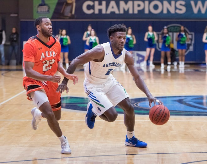Jon Brown (2) dribbles during the Auburn University at Montgomery vs UWF men's basketball game at the University of West Florida in Pensacola on Thursday, Jan. 23, 2020
