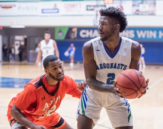 Jon Brown (2) looks to pass the ball during the Auburn University at Montgomery vs UWF men's basketball game at the University of West Florida in Pensacola on Thursday, Jan. 23, 2020