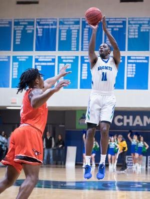 Tarik McKelphin (11) shoots during the Auburn University at Montgomery vs UWF men's basketball game at the University of West Florida in Pensacola on Thursday, Jan. 23, 2020