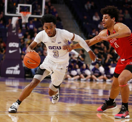 GCU's Mikey Dixon (3) drives to the basket against Seattle University's Riley Grigsby (11) during the first half at Grand Canyon University Arena in Phoenix, Ariz. on January 23, 2020.