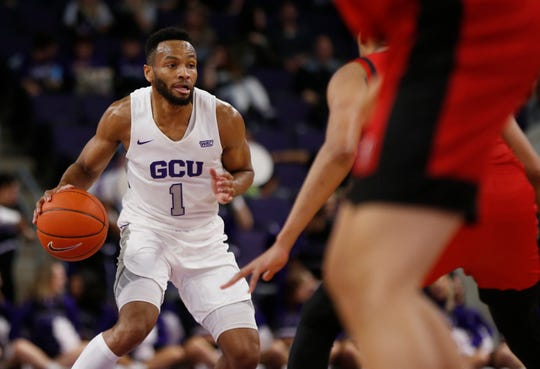 GCU's Isiah Brown (1) dribbles up the court against Seattle University during the first half at Grand Canyon University Arena in Phoenix, Ariz. on January 23, 2020.