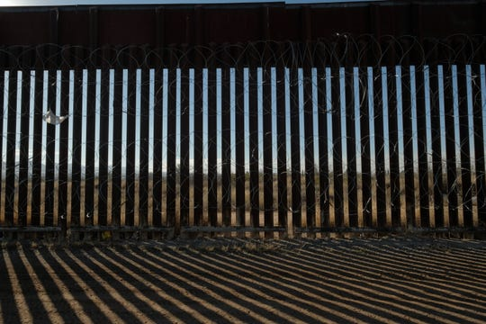 18-foot bollard-style fencing, built during the Bush administration, is seen east of Douglas on Jan. 8, 2020.