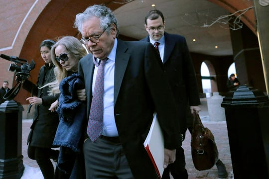 Insys Therapeutics founder John Kapoor, front, departs federal court Thursday, Jan. 23, 2020, in Boston, after he was sentenced to 5 1/2 years in prison for orchestrating a bribery and kickback scheme prosecutors said helped fuel the opioid crisis.