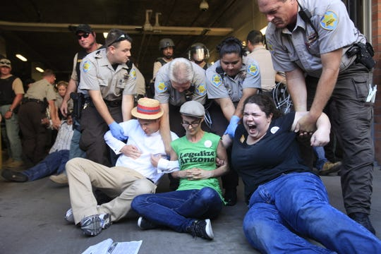 Protestors gets arrested for civil disobedience at outside Maricopa County Jail on 4th Ave in Phoenix(cq) on the first day of the new law, SB 1070 on Thursday July 29, 2010 .