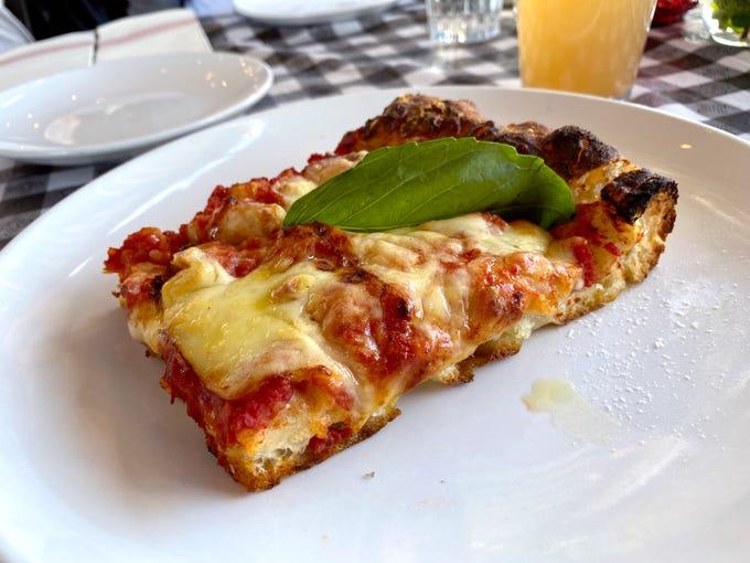 Siclian slice with Bianco di Napoli tomato sauce, fontina cheese and fresh basil at Pane Bianco Van Buren in Phoenix.