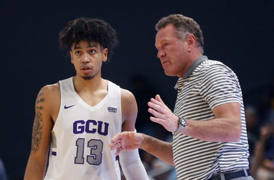 GCU's head coach Dan Majerle talks with Lorenzo Jenkins (13) in a game  at Grand Canyon University Arena in Phoenix, Ariz. on January 23, 2020. Majerly says Jenkins will need to step up in coming games for the Lopes.