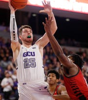 GCU's Alessandro Lever (25) shoots over Seattle University's Myles Carter during the second half at Grand Canyon University Arena in Phoenix, Ariz. on January 23, 2020.