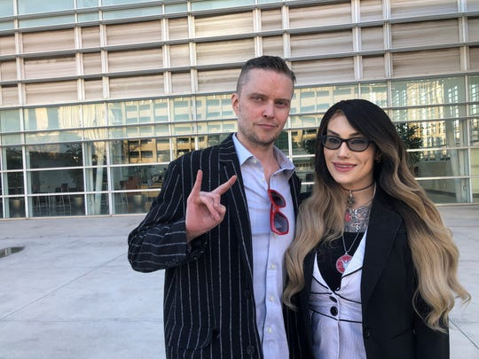 Douglas Misicko, left, better known as Lucien Greaves, and Michelle Shortt, stand outside the U.S. District Court in downtown Phoenix. Greaves is the co-founder of the Satanic Temple, while Shortt is the former head of the Arizona chapter.