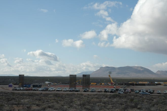 A parking lot for construction workers building new 30-foot bollard-style fencing just east of the San Bernardino National Wildlife Refuge in southeast Arizona on Jan. 10, 2020.