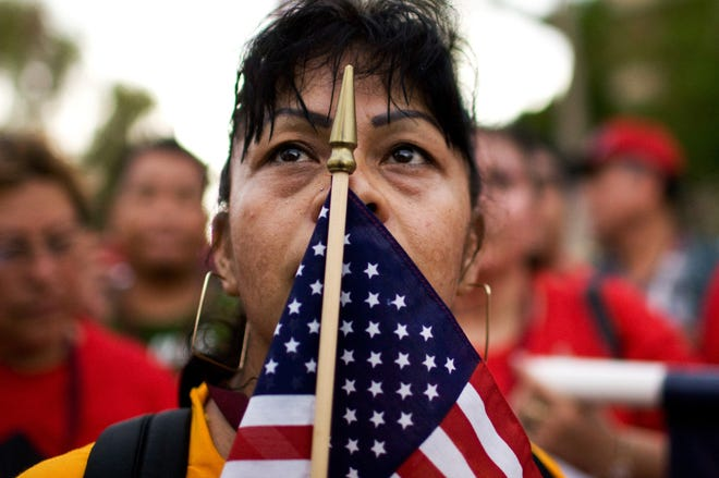 Maria Zamora traveled from Los Angeles by bus to protest against Arizona's SB 1070 on July 29, 2010.