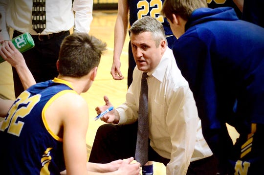 Port Huron Northern coach Brian Jamison talks to his team during a timeout against Sterling Heights during a Macomb Area Conference-Gold boys basketball game on Thursday, Jan. 23, 2020.