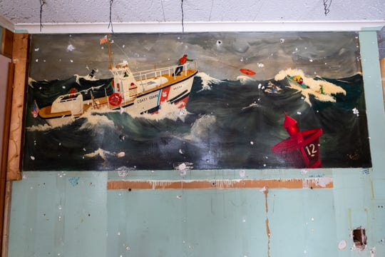 A mural was discovered underneath wood paneling during restoration work on the U.S. Coast Guard building at Fort Gratiot Light Station. The mural is believed to be from the 1950's or '60s.