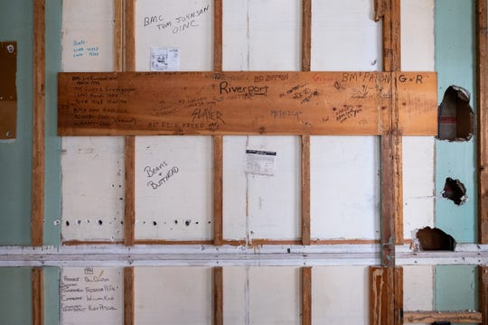 Names, handwritten facts, a Far Side calendar and other things that were covered up in 1994 were found beneath the wall paneling in the radio room during restoration work on the U.S. Coast Guard building at Fort Gratiot Light Station.