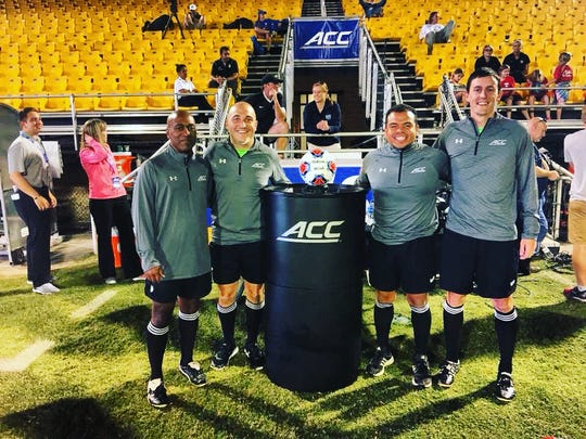Sergio Gonzalez (right-middle) has made the journey from Franklin County youth soccer ref to ACC official.