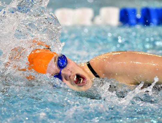 York Suburban's Cajsa Fryar wins the 100 Yard Freestyle event at 1:00.12 over Dover during swimming action at Dover Intermediate School in Dover Township, Thursday, Jan. 23, 2020. Dawn J. Sagert photo