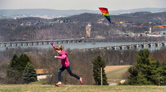 Hannah Lentz, age 11, of Lower Windsor Township flies a kite at Samuel S. Lewis State Park Sunday April 6, 2014 in Lower Windsor Township. Across the Susquehanna River at top right is Columbia.